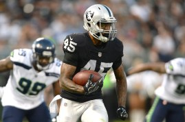 Oakland Raiders running back George Atkinson (45) runs for nine yards in the first quarter as the Seattle Seahawks face the Oakland Raiders at Oakland Coliseum in Oakland, Calif., on Thursday, August 31, 2017.