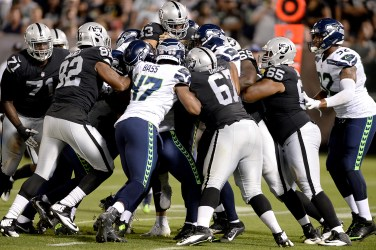 Oakland Raiders running back John Crockett (43) is stopped in the first half as the Seattle Seahawks face the Oakland Raiders at Oakland Coliseum in Oakland, Calif., on Thursday, August 31, 2017.