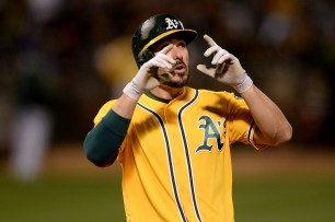 Oakland Athletics right fielder Matt Joyce (23) looks up to the sky after a home run as the Los Angeles Angels face the Oakland Athletics at Oakland Coliseum in Oakland, Calif., on Saturday, April 1, 2017.