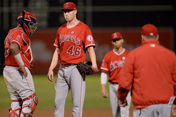 Los Angeles Angels relief pitcher Cory Rasmus (46) is relieved after giving up three home runs in the fifth inning as the Los Angeles Angels face the Oakland Athletics at Oakland Coliseum in Oakland, Calif., on Saturday, April 1, 2017.