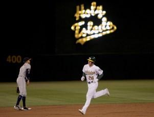 Oakland Athletics third baseman Matt Chapman (26) rounds the bases after a second inning home run as the Houston Astros face the Oakland Athletics at Oakland Coliseum in Oakland, Calif., on Friday, September 8, 2017.