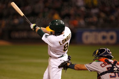 Oakland Athletics second baseman Jed Lowrie (8) swings the bat to hit a walk off single during the ninth inning of their game against the Houston Astros at the Oakland Coliseum on Friday September 08, 2017. Athletics won 9-8.