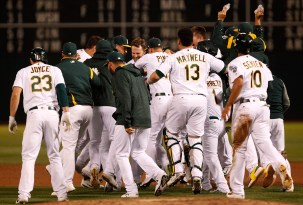 Players celebrate after Oakland Athletics second baseman Jed Lowrie (8) hit a walk off single in the 9-8 victory over the Houston Astros at the Oakland Coliseum on Friday September 8, 2017.