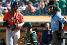 Houston Astros catcher Brian McCann (16) has words with home plate umpire Ramon De Jesus after a called strike in the seventh inning of the game against the Oakland Athletics at the Oakland Coliseum in Oakland, Calif., on September 10, 2017.