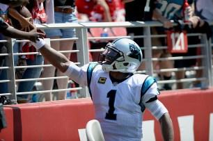 Carolina Panthers starting quarterback Cam Newton (1) hands the ball to a fan after a TD as the Carolina Panthers face the San Francisco 49ers at Levi's Stadium in Santa Clara, Calif., on Sunday, September 10, 2017.