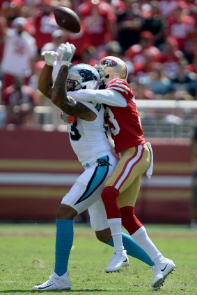 San Francisco 49ers' Rashard Robinson (33) breaks up a pass intended for Carolina Panthers' Kelvin Benjamin (13) as the Carolina Panthers face the San Francisco 49ers at Levi's Stadium in Santa Clara, Calif., on Sunday, September 10, 2017.