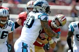 Carolina Panthers' Julius Peppers (90) brings down San Francisco 49ers starting quarterback Brian Hoyer (2) in the first half as the Carolina Panthers face the San Francisco 49ers at Levi's Stadium in Santa Clara, Calif., on Sunday, September 10, 2017.