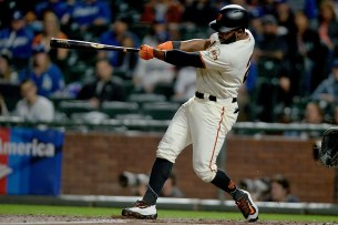San Francisco Giants center fielder Denard Span (2) homers in the first inning as the Los Angeles Dodgers face the San Francisco Giants at AT&T Park in San Francisco, Calif., on Monday, September 11, 2017.