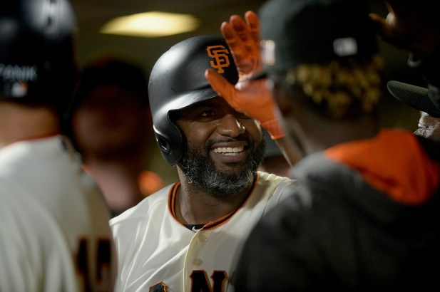 San Francisco Giants center fielder Denard Span (2) is congratulated after hitting a home run in the first inning as the Los Angeles Dodgers face the San Francisco Giants at AT&T Park in San Francisco, Calif., on Monday, September 11, 2017.