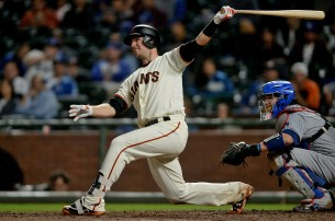 San Francisco Giants first baseman Buster Posey (28) watches an RBI double as the Los Angeles Dodgers face the San Francisco Giants at AT&T Park in San Francisco, Calif., on Monday, September 11, 2017.