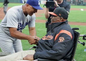 Los Angeles Dodgers manager Dave Roberts (30) greets Hall of Famer Willie McCovey as the Giants celebrate African American Heritage Night before the Los Angeles Dodgers face the San Francisco Giants at AT&T Park in San Francisco, Calif., on Wednesday, September 13, 2017.
