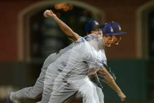 Los Angeles Dodgers pitcher Yu Darvish (21) throws a pitch in the third inning as seen in this multiple exposure image as the Los Angeles Dodgers face the San Francisco Giants at AT&T Park in San Francisco, Calif., on Wednesday, September 13, 2017.