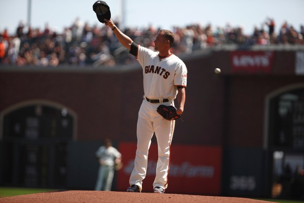 San Francisco Giants former pitcher Ryan Vogelsong (32) waves to fans after throwing a pitch during his retirement ceremony before the game against Arizona Diamondbacks at the AT&T Park on Sunday September 17, 2017.