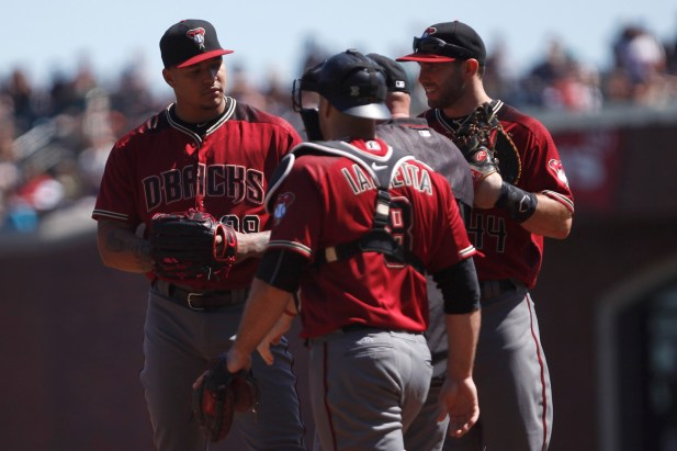 Arizona Diamondbacks pitcher Taijuan Walker (99) talks with Arizona Diamondbacks pitching coach Mike Butcher (23) and rest of team in the first inning as the Arizona Diamondbacks face the San Francisco Giants at the AT&T Park on Sunday September 17, 2017.