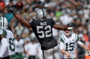 Oakland Raiders defensive end Khalil Mack (52) attempts to block a pass from New York Jets quarterback Josh McCown (15) as the New York Jets face the Oakland Raiders at Oakland Coliseum in Oakland, Calif., on Sunday, September 17, 2017.