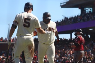 San Francisco Giants first baseman Pablo Sandoval (48) celebrates with San Francisco Giants catcher Nick Hundly (5) after hitting a home run in the sixth inning as the Arizona Diamondbacks face the San Francisco Giants at the AT&T Park on Sunday September 17, 2017.