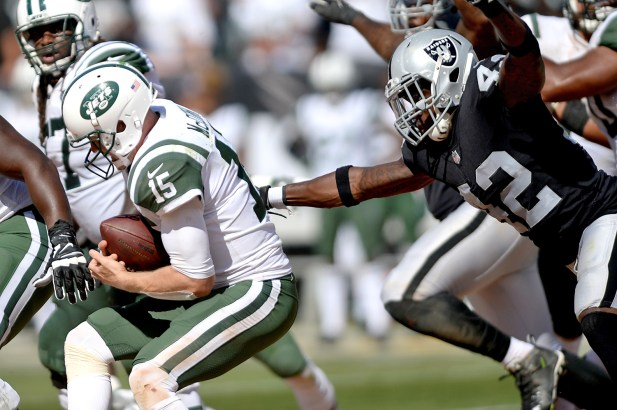 Oakland Raiders safety Karl Joseph (42) sacks New York Jets quarterback Josh McCown (15) in the second half as the New York Jets face the Oakland Raiders at Oakland Coliseum in Oakland, Calif., on Sunday, September 17, 2017.