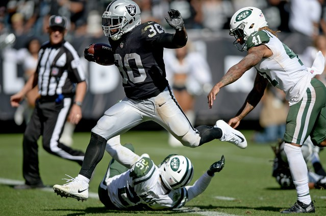 Oakland Raiders running back Jalen Richard (30) scores a TD in the second half as the New York Jets face the Oakland Raiders at Oakland Coliseum in Oakland, Calif., on Sunday, September 17, 2017.