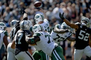 Oakland Raiders defense pressures New York Jets quarterback Josh McCown (15) in the first half as the New York Jets face the Oakland Raiders at Oakland Coliseum in Oakland, Calif., on Sunday, September 17, 2017.