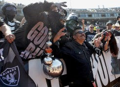 Comedian George Lopez poses for a photo in front of Raiders fans in the Black Holea before the New York Jets face the Oakland Raiders at Oakland Coliseum in Oakland, Calif., on Sunday, September 17, 2017.