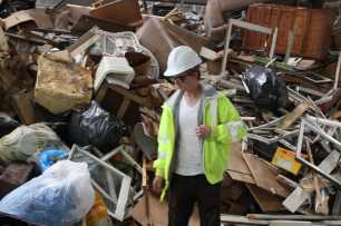 Curtis Reid Henderson searches for things he can use in Recology's garbage pile.