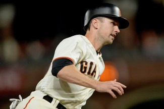 San Francisco Giants catcher Buster Posey (28) scores on a Sandoval single in the fourth inning as the Colorado Rockies face the San Francisco Giants at AT&T Park in San Francisco, Calif., on Tuesday, September 19, 2017.