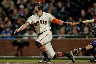 San Francisco Giants right fielder Hunter Pence (8) connects for a two run home run as the Colorado Rockies face the San Francisco Giants at AT&T Park in San Francisco, Calif., on Tuesday, September 19, 2017.