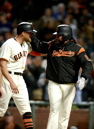 San Francisco Giants starting pitcher Johnny Cueto (47) congratulates San Francisco Giants right fielder Hunter Pence (8) after a home run as the Colorado Rockies face the San Francisco Giants at AT&T Park in San Francisco, Calif., on Tuesday, September 19, 2017.