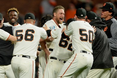 San Francisco Giants right fielder Hunter Pence (8) and teammates celebrate a walk off 4-3 victory over the Colorado Rockies at AT&T Park in San Francisco, Calif., on Tuesday, September 19, 2017.