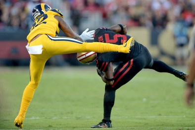San Francisco 49ers' Pierre Garcon (15) shakes a tackle in the first half as the Los Angeles Rams face the San Francisco 49ers at Levi's Stadium in Santa Clara, Calif., on Thursday, September 21, 2017.