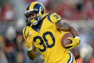 Los Angeles Rams running back Todd Gurley (30) runs for a gain in the first half as the Los Angeles Rams face the San Francisco 49ers at Levi's Stadium in Santa Clara, Calif., on Thursday, September 21, 2017.