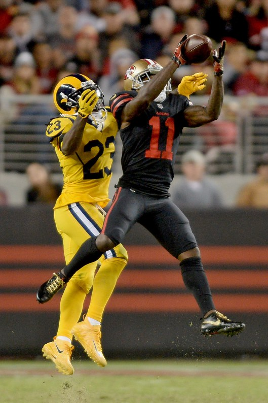 San Francisco 49ers' Marquise Goodwin (11) makes a catch in the second half as the Los Angeles Rams face the San Francisco 49ers at Levi's Stadium in Santa Clara, Calif., on Thursday, September 21, 2017.