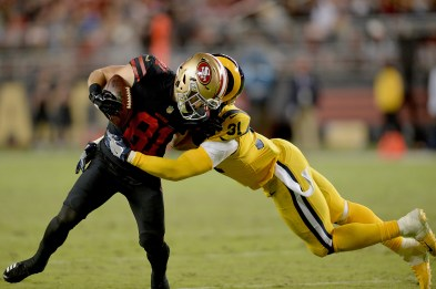 San Francisco 49ers' Trent Taylor (81) shakes a tackle by Los Angeles Rams safety Maurice Alexander (31) in the second half as the Los Angeles Rams face the San Francisco 49ers at Levi's Stadium in Santa Clara, Calif., on Thursday, September 21, 2017.