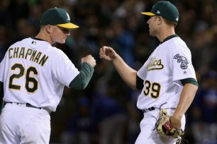 Oakland Athletics third baseman Matt Chapman (26) and Oakland Athletics relief pitcher Blake Treinen (39) congratulate each other after winning their game against the Texas Rangers at the Oakland Coliseum in Oakland, Calif. on Saturday, September 23, 2017. Athletics won 1-0.