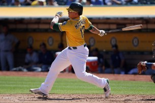Oakland Athletics catcher Bruce Maxwell (13) hits the ball in the second inning as the Seattle Mariners take on the Oakland Athletics at the Oakland Coliseum on Wednesday, September 27, 2017.