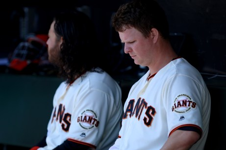 San Francisco Giants pitcher Matt Cain (18) sits in the dugout as the San Diego Padres take on the San Francisco Giants at AT&T Park on Saturday, September 30, 2017.