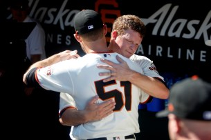 San Francisco Giants pitcher Matt Cain (18) hugs San Francisco Giants Mac Williamson (51) in the dugout after pitching his last inning as the San Diego Padres take on the San Francisco Giants at AT&T Park on Saturday, September 30, 2017.