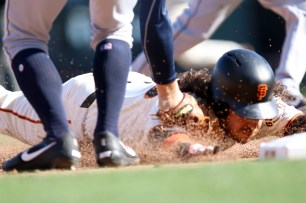 San Francisco Giants short stop Brandon Crawford (35) gets tagged out after trying to steal third base in the eighth inning as the San Diego Padres take on the San Francisco Giants at AT&T Park on Saturday, September 30, 2017. Giants lost 2-3.