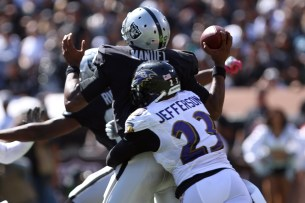 Oakland Raiders quarter back EJ Manuel (3) gets sacked by Baltimore Ravens safety Tony Jefferson (23) while lookingto pass in the second quarter as the Baltimore Ravens take on the Oakland Raiders at the Oakland Coliseum on Sunday, October 8, 2017. The Ravens won 30-17.