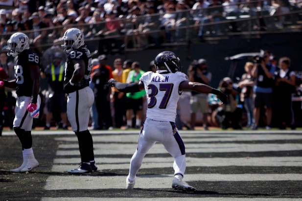 Baltimore Ravens running back Javorius Allen (37) celebrates after scoring a touchdown in the second quarteras the Baltimore Ravens take on the Oakland Raiders at the Oakland Coliseum on Sunday, October 8, 2017. The Ravens won 30-17.