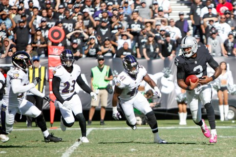 Oakland Raiders quarter back EJ Manuel (3) runs the ball in the third quarter as the Baltimore Ravens take on the Oakland Raiders at the Oakland Coliseum on Sunday, October 8, 2017. The Ravens won 30-17.