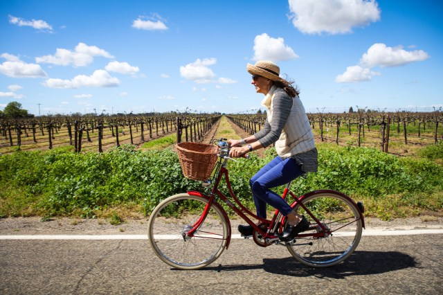 Woman biking in Lodi, California wine country
