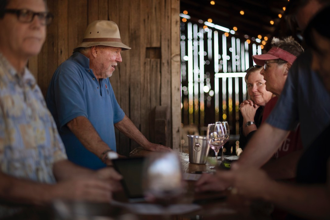 Soda Rock Winery owner Ken Wilson, 2nd from left, chatting with customers. | Erik Castro / Special to The Chronicle