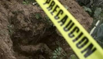 En una fosa clandestina, localizan por lo menos cuatro cuerpos