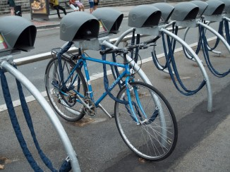 "Bike ""lockers"" with something to keep the seat dry"