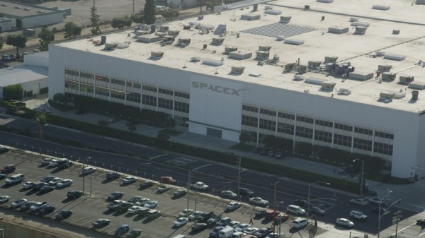 8K stock footage aerial video orbiting SpaceX HQ and ...