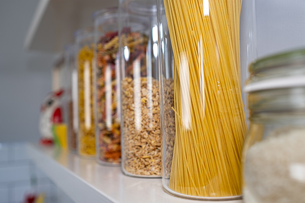 Plastic containers on pantry shelf