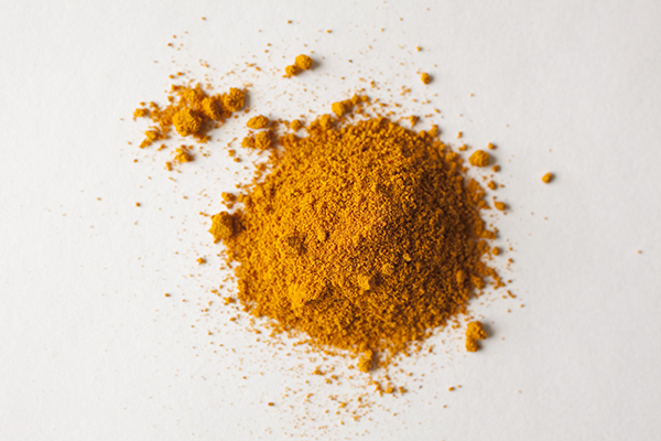 A pile of turmeric shot on white