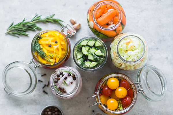 Pickled vegetables in glass jars