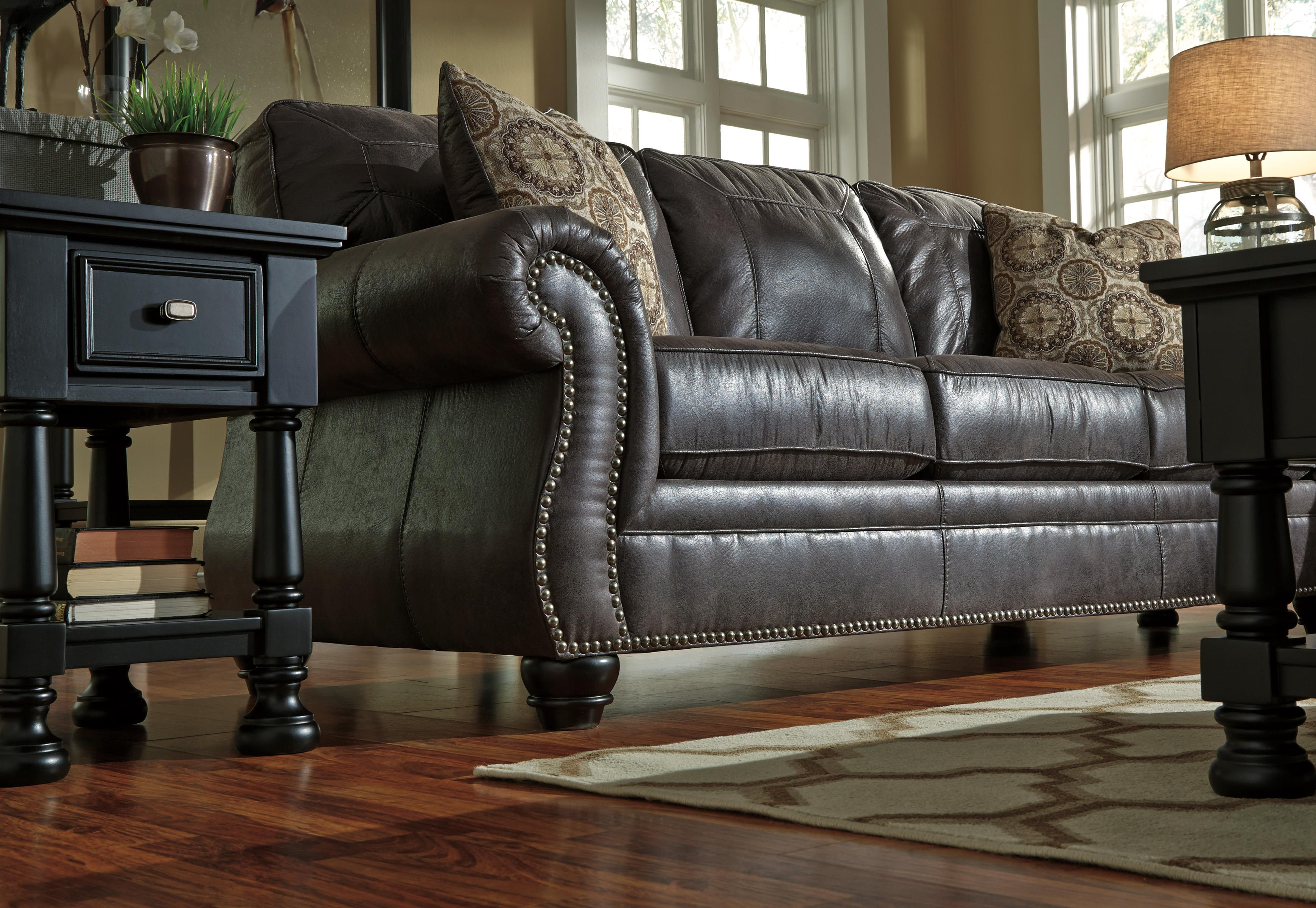 Faux Leather Sofa With Rolled Arms And Nailhead Trim By